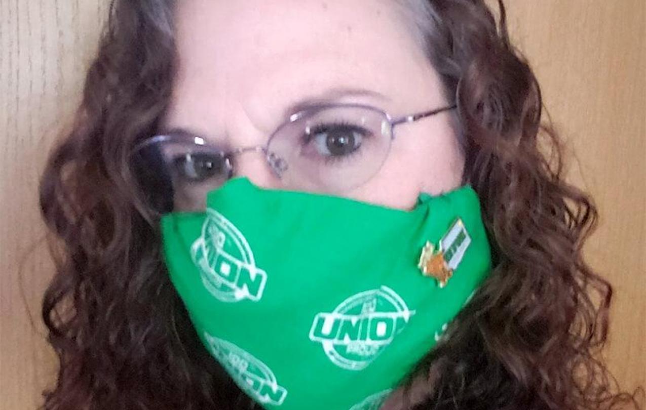 Woman wearing Union decorated mask